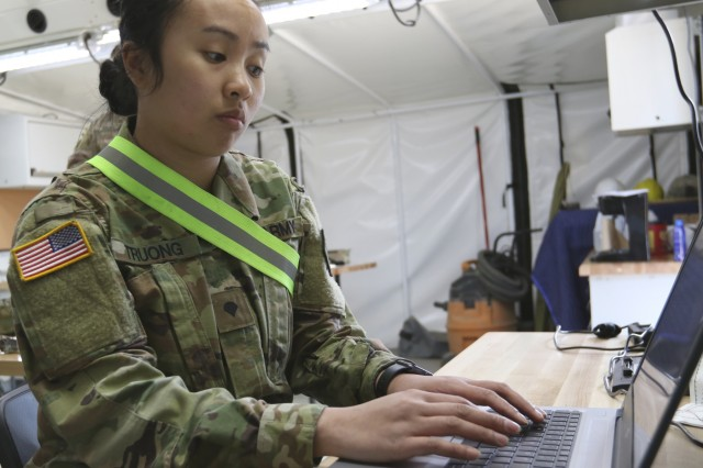 U.S. Army Reserve Spc. Bichthuy Truong ,from the 804th Movement Control Team, updates equipment receipt information online as part of her task at Exercise Maple Resolve 19-01 on May 10, 2019, 3rd Canadian Division Support Base Det Wainwright. Maple Resolve is an annual brigade-level validation exercise for the Canadian Army's High Readiness Brigade and is designed to develop partnership among forces and increase interoperability. (Photo by U.S. Army Reserve Spc. Jermaine Jackson)