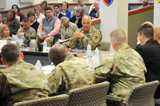 During Joint Munitions Command's quarterly brief, Gen. Gus Perna, Army Materiel Command Commanding General, center, speaks with Brig. Gen. Michelle M. T. Letcher, left, and JMC senior leaders.