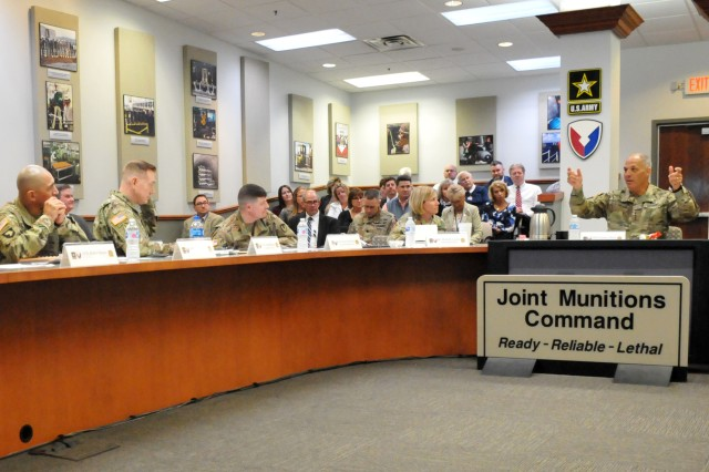 Gen. Gus Perna, Army Materiel Command Commanding General, right, speaks with Brig. Gen. Michelle M. T. Letcher, center, and Joint Munitions Command senior leaders during JMC's quarterly brief.