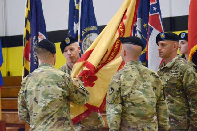 U.S. Army Garrison Italy commander, Col. Erik M. Berdy, passes the unit guidon to Command Sgt. Maj. Billy S. Vetten during a change of responsibility ceremony that took place in the physical fitness center on Caserma Ederle May 29. Vetten assumed responsibility from Command Sgt. Maj. Mason L. Bryant (right), who has served as USAG Italy command sergeant major for the past 30 months.
