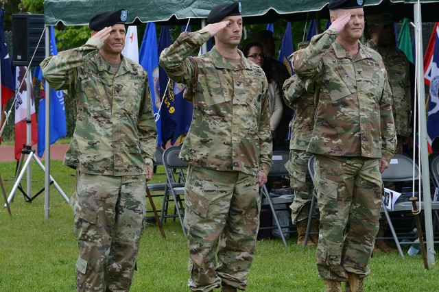 U.S. Army Brig. Gen. Ronald T. Stephens, left, commanding general for Regional Health Command Europe, stands in the position of honor as the reviewing officer during the May 29 change of command ceremony for Landstuhl Regional Medical Center. Col. Timothy L. Hudson, center, transferred authority and responsibility of the hospital to LRMC's new commander, Col. Michael A. Weber, right. Landstuhl Regional Medical Center is the only American Level III trauma center outside of the continental United States, and serves as the premiere medical readiness platform and healthcare facility for service members from U.S. European Command, U.S. Africa Command, U.S. Central Command, U.S. Transportation Command and Special Operations Command. (U.S. Army photo by Liz Paque)