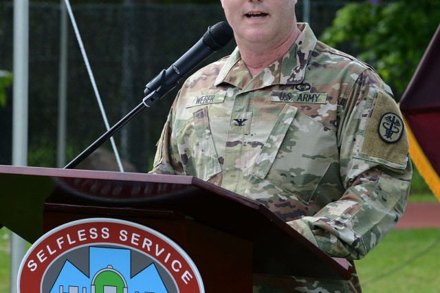 U.S. Army Col. Michael A. Weber gives his first remarks as the 34th commander of Landstuhl Regional Medical Center during the May 29 change of command ceremony.  Weber is triple board-certified in general surgery, vascular surgery and management, and comes to LRMC after having served as the command surgeon for U.S. Africa Command in Stuttgart, Germany. (U.S. Army photo by Liz Paque)