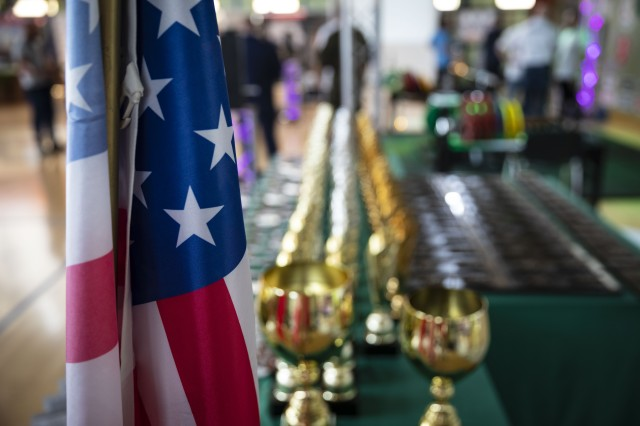 The American flag stands in front of the awards table during the 1st World Bench Press Championships of the Uniformed Services at Wroclaw, Poland, May 24 - 26, 2019. Eight service members, with 1st Armored Brigade Combat Team, 1st Infantry Division, competed as part of over 100 uniformed athletes at the international competition open to active and retired military service members and uniformed services. (U.S. Army photo by Sgt. Thomas Mort)