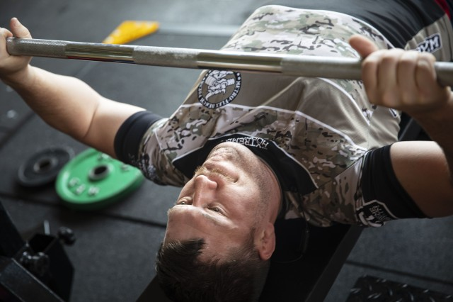 U.S. Air Force Senior Airman Kendall Davis, brigade staff weather officer with 7th weather squadron, 1st Armored Brigade Combat Team, 1st Infantry Division, warms up with a lift, during the 1st World Bench Press Championships of the Uniformed Services at Wroclaw, Poland, May 24 - 26, 2019. Eight service members, with 1st Armored Brigade Combat Team, 1st Infantry Division, competed as part of over 100 uniformed athletes at the international competition open to active and retired military service members and uniformed services. (U.S. Army photo by Sgt. Thomas Mort)