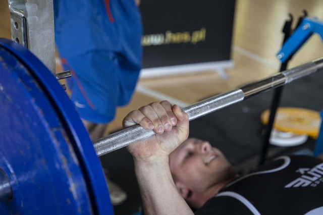 U.S. Army Sgt. Joshua Closser, from Charlie Battery, 1st Battalion, 174th Air Defense Regiment, warms up with a lift, during the 1st World Bench Press Championships of the Uniformed Services at Wroclaw, Poland, May 24 - 26, 2019. Eight service members, with 1st Armored Brigade Combat Team, 1st Infantry Division, competed as part of over 100 uniformed athletes at the international competition open to active and retired military service members and uniformed services. (U.S. Army photo by Sgt. Thomas Mort)