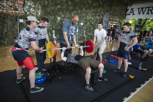 Service members with 1st Armored Brigade Combat Team, 1st Infantry Division, warmup during the 1st World Bench Press Championships of the Uniformed Services at Wroclaw, Poland, May 24 - 26, 2019. Eight service members, with 1st Armored Brigade Combat Team, 1st Infantry Division, competed as part of over 100 uniformed athletes at the international competition open to active and retired military service members and uniformed services. (U.S. Army photo by Sgt. Thomas Mort)