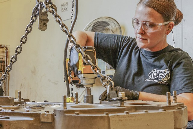 Jennifer Keller disassembles an AGB module for an AGT 1500 turbine engine. Wearing proper personal protective equipment and following work instructions are some of the keys to ensuring Anniston Army Depot achieves its Voluntary Protection Program goal.