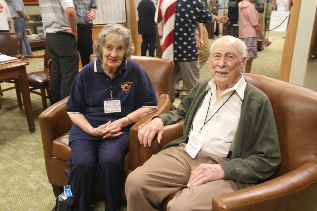 Dr. Eldon Knuth sits with his wife, Margaret, in the 95th Infantry Division Memorial at the Armed Forces Reserve Center here. Serving as a mortar team member, he helped liberate Metz, France, from German occupation.