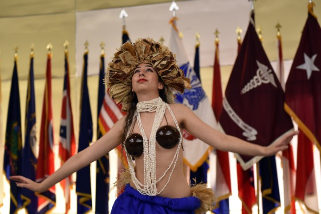 A dancer from Hoku's Hawaiian Entertainment performs a Tahitian dance during an Asian American and Pacific Islander heritage month celebration at Fort Detrick, Maryland, May 22.