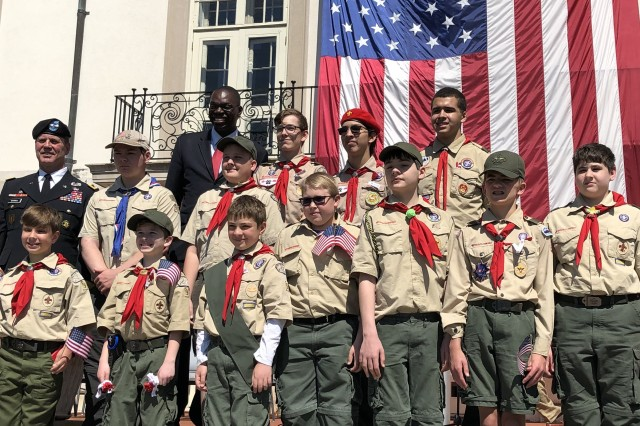 Boy Scouts from Troop No. 96 in Grosse Pointe, Michigan, capture the moment by posing for a photo with Maj. Gen. Mitchell and Michigan Lt. Gov. Garlin Gilchrist.