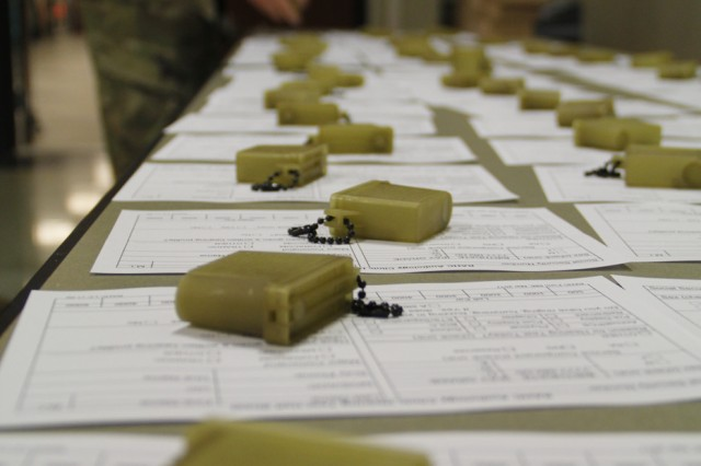 Hearing protection and paperwork lay ready to go for the Soldiers of 2nd Battalion, 18th Field Artillery, as they conduct their annual hearing health brief.