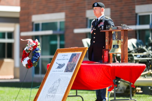 U.S. Army Command Sgt. Maj. Paul Fluharty, senior enlisted leader for 2nd Battalion, 77th Field Artillery Regiment, 2nd Infantry Brigade Combat Team, 4th Infantry Division, stands in front of a bell dedicated to Sgt. Elijah Rao, May 24, 2019, during a memorial ceremony on Fort Carson, Colorado. Rao was killed during an improvised explosive device attack in Afghanistan on Dec. 5, 2009. (U.S. Army photo by Staff Sgt. Neysa Canfield)