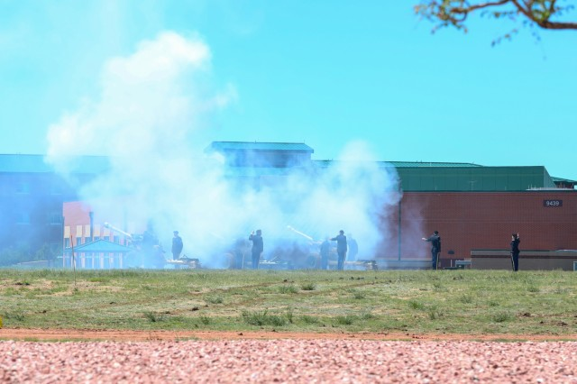 U.S. Army Soldiers assigned to the 2nd Battalion, 77th Field Artillery Regiment, 2nd Infantry Brigade Combat Team, 4th Infantry Division, perform salute battery honors, May 24, 2019, during a memorial ceremony on Fort Carson, Colorado. Soldiers from 2nd Bn., 77th FA Reg., 2IBCT conducted the ceremony to commemorate the fallen Soldiers of the battalion. (U.S. Army photo by Staff Sgt. Neysa Canfield)