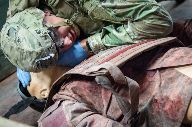 Sgt. Jacob Preisler, a native of San Diego and cavalry scout assigned to 2nd Squadron, 13th Cavalry Regiment, 3rd Brigade Combat Team, 1st Armored Division, simulates listening for a casualty's breathing while performing tactical combat casualty care as part of the medical testing portion of the 1st Armored Division's 2019 Best Warrior Competition May 13 at Fort Bliss, Texas.  The 2019 Best Warrior Competition pushed each individual Soldier to the limit testing their skills in a challenging and face-paced environment. The winners will now compete at the next hierarchical level competition, the 2019 III Corps Best Warrior in Fort Hood, Texas later this year.