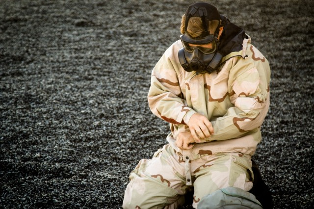 Sgt. Quienten Amore, a native of West Plains, Missouri, and an infantryman with 3rd Battalion, 41st Infantry Regiment, 1st Stryker Brigade Combat Team, 1st Armored Division, dons mission oriented protective posture (MOPP) gear designed to limit exposure to toxic environments, while competing in the 1st Armored Division's 2019 Best Warrior Competition May 13 at Fort Bliss, Texas.  The 2019 Best Warrior Competition took place over the course of four days. Individuals were tested in skills such as chemical, biological radiation, nuclear and explosives (CBRNE) preparedness, applying medical skills, weapons proficiency, physical fitness, land navigation and hand-to-hand combatives to determine 1AD's top junior enlisted Soldier and Noncommissioned Officer.