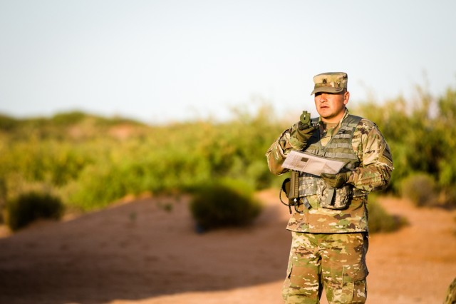 Staff Sgt. Mike Aguayo, a native of Los Angeles and a tactical power generation specialist assigned to 3rd Squadron, 6th Cavalry Regiment, Combat Aviation Brigade, 1st Armored Division, uses a compass to find the correct direction to travel to a set location during the land navigation portion of 1st Armored Division's 2019 Best Warrior Competition May 16 at Fort Bliss, Texas.  Land navigation is an integral aspect of a Soldier's warrior skills to ensure Soldiers are  agile and ready to navigate through challenging terrain during combat missions in remote and austere environments.