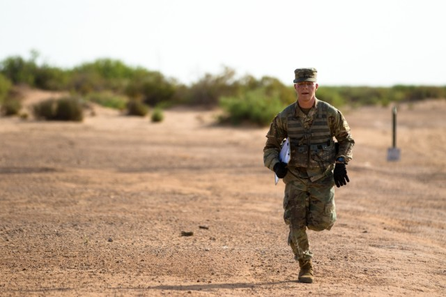 Sgt. Quienten Amore, a native of West Plains, Missouri, and an infantryman with 3rd Battalion, 41st Infantry Regiment, 1st Stryker Brigade Combat Team, 1st Armored Division, sprints towards the finish marker during the land navigation portion of the 1st Armored Division Best Warrior Competition May 16 at Fort Bliss, Texas.  Soldiers were given four hours to plot location points on a map and transverse the land navigation course to reach and identify each marker in the early morning as night turned into day.
