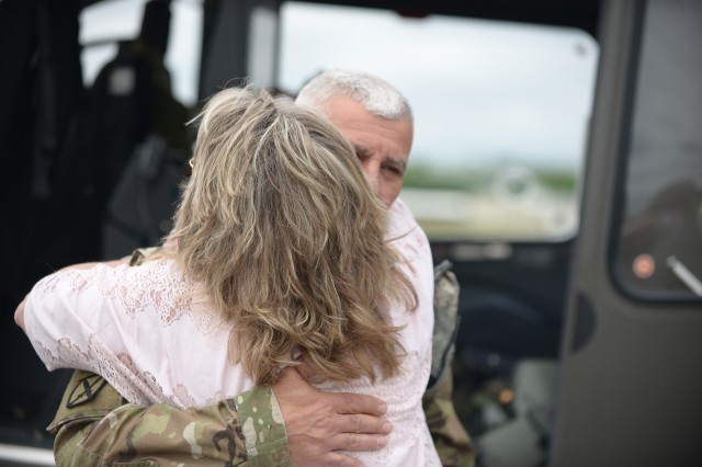 New York Army National Guard Sgt. Maj. Joseph Marino hugs his wife Brenda at the Army Aviation Facility, Latham, N.Y., May 29, 2019, following a final flight. Marino was honored with a final flight after 33 years of service at the New York Army National Guard's Latham flight facility.