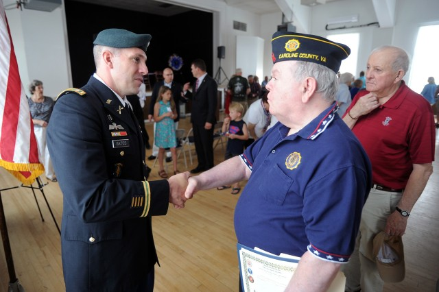 U.S. Army Garrison Fort A.P. Hill commander Lt. Col. Michael E. Gates joined Veterans and community members to honor the fallen today at the annual Memorial Day commemoration in the Bowling Green Town Hall.