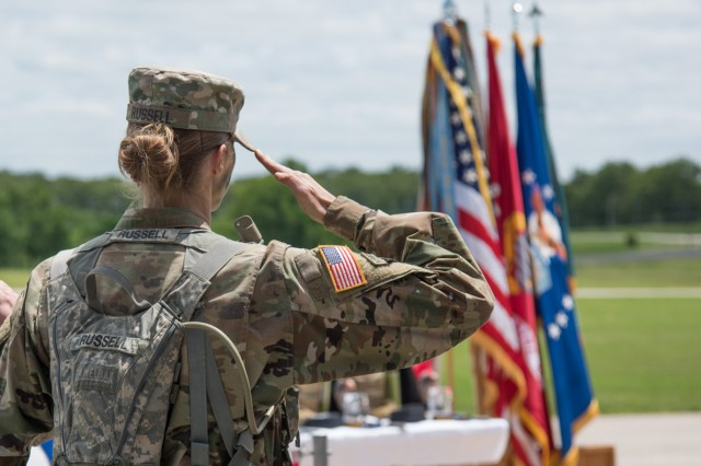 Sgt. 1st Class Marianne Russell, MSCoE and Fort Leonard Wood Drill Sergeant of the Year, salutes the flag during the MSCoE Best Warrior Competition award ceremony May 10. Russell said the R2 program helped give her the edge needed to reach her goal of winning the title. Russell is scheduled to represent MSCoE in the U.S. Army Training and Doctrine Command level competition in July at Fort Rucker, Ala