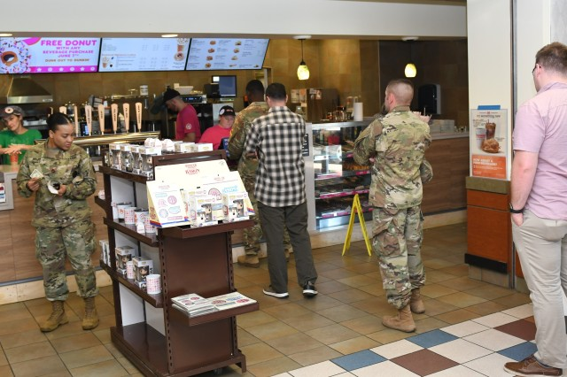 Customers stand in line at Dunkin' the new doughnut and coffee shop at the Fort Knox Mini Mall. Brenda Bynum, a services business manager with AAFES, said the location facilitates the morning traffic coming in from the north side of the installation.