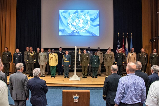 24 Army War College students stand at attention as they are recognized for their service to U.N. peacekeeping duties throughout the world during the International Day of United Nations Peacekeepers ceremony held in Bliss Hall, Carlisle Barracks, May 30.