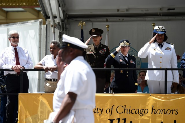 From left to right: Jim Frazier, Gold Star Family father of Staff Sgt. Jacob Frazier killed on March 29, 2003; Chicago Mayor Lori Lightfoot; Maj. Gen. Marion Garcia, Commanding General, 200th Military Police Command; Brig. Gen. Kris Belanger, Commanding General, 85th U.S. Army Reserve Support Command; and Commander Zeita Merchant, Commanding Officer, MSU Chicago, U.S. Coast Guard view the Chicago Memorial Day parade from the reviewing stand, Mar. 25, 2019. Soldiers assigned to the 85th U.S. Army Reserve Support Command participated in parades and ceremonies, honoring fallen heroes, during Memorial Day weekend May 25-27, 2019. Belanger, and Command Sgt. Maj. Theodore Dewitt, Command Sergeant Major, 85th USARSC, participated in a Gold Star Family Breakfast Saturday morning in Chicago to honor the sacrifice of fallen military heroes and then walked to Daley Plaza to participate in a wreath laying ceremony. Garcia, who was the Chicago parade Grand Marshal, shared a emotional story at the ceremony about a Soldier she had served with who died on active duty. Following the ceremony, military leaders walked to Lake and State Street for the Chicago Memorial Day parade and observed the parade from the reviewing stand. On Sunday, Belanger led ten new Army recruits in the oath of enlistment and delivered a speech at the Memorial Day observance in Norridge, Illinois. Later that day, Belanger and Dewitt finished the Memorial Day weekend by participating in the Arlington Heights Centennial Memorial Day parade. In North suburban Highland Park, Col. Daniel Jaquint, 85th USARSC, gave remarks at a Memorial Day service. (U.S. Army Reserve photo by Anthony L Taylor)
