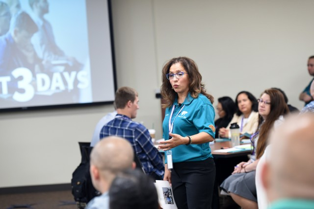 Carmella Navarro, Suicide Prevention Program Manager, 85th U.S. Army Reserve Support Command, gives remarks during the 85th USARC's 'Stand For Life' suicide prevention training, May 6-10, 2019, at the 85th USARSC headquarters. The week-long training event provided suicide prevention program liaisons, from the command's subordinate units, the opportunity to develop connections at the unit level and these connections will provide SPPLs with visibility, accountability, dialog and the support needed to break stigmas and identify authentic methods to successfully escort a Soldier to safety, away from suicidal ideations. Across the course of the training, numerous stories were shared from trainers and participants on how suicide impacted them but also shared and taught was how to be aware of those suffering from ideations and how to be there for those in need. (U.S. Army Reserve photo by Anthony L. Taylor)