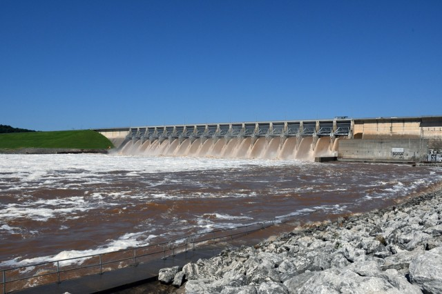 The U.S. Army Corps of Engineers Tulsa District's Keystone Dam releases water from its flood poll May 30. The flood pool is water that lies above the lake's conservation pool and is used to regulate floodwater. (U.S. Army photo by Patrick Bray/Released)