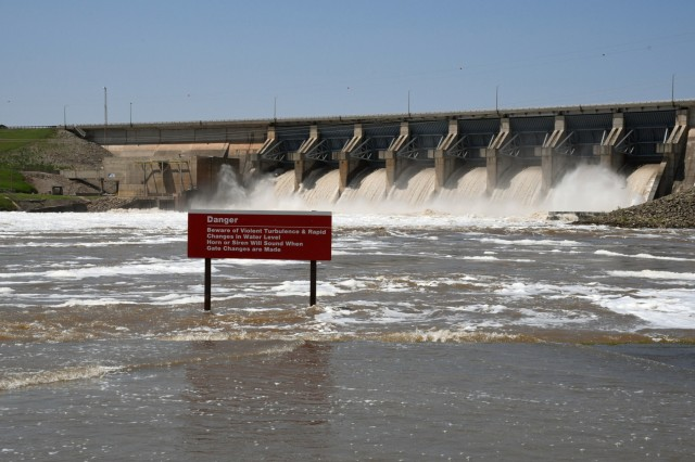 A sign warns visitors of turbulent waters below the spillway at the U.S. Army Corps of Engineers Tulsa District's Kaw Lake May 30 as the district releases water from its flood poll. The flood pool is water that lies above the lake's conservation pool and is used to regulate floodwater. (U.S. Army photo by Patrick Bray/Released)