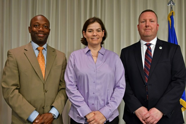 From left to right, Gary Shuler, a logistics management specialist, Bethany Himel, a traffic management specialist, and Anthony McKee, an occupational safety and health manager, graduated from the Air Mobility Command Civilian Leadership Development Program at Scott Air Force Base, May 30. (Photo by Alyssa Crockett)