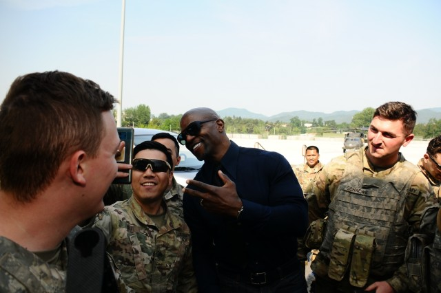 CAMP HUMPHREYS, Republic of Korea - Terry Crews takes selfies with fans during a visit to South Korea to share his story of resilience and encourage victims to come forward, May 29, on Camp Carroll. The Eighth U.S. Army Sexual Harassment/Assault Response and Prevention (SHARP) office hosted the Terry and Rebecca Crew's four-day speaking tour to raise awareness and reduce social stigma victims may perceive. (U.S. Army photo by Sgt. Ian Vega-Cerezo, 2ID/RUCD Public Affairs)