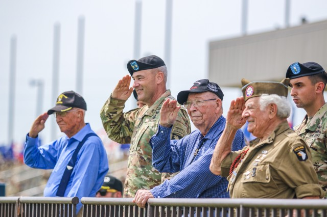 Maj. Gen Brian Winski (second from right), commanding general of the 101st Airborne Division (Air Assault), is joined by WWII 101st Abn. Div. Veterans Bradford Freeman, Russell Mann (seated), Alan Bastian, and Vince Speranza to salute passing troops, at the 101st Abn. Div. Week of the Eagles Division Review ceremony, May 23, 2019 at Fort Campbell, Kentucky. Week of the Eagles is an annual 101st Abn. Div. and Fort Campbell series of events to celebrate the rich history and legacy of the Screaming Eagles, honor our Veterans and fallen Soldiers, and strengthen bonds with our Veterans, Families, and community members.