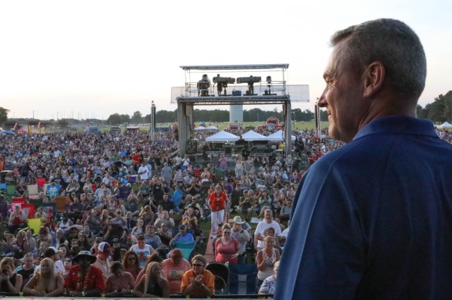 Maj. Gen Brian Winski, commanding general of the 101st Airborne Division (Air Assault), prepares to welcome thousands of Soldiers, Families and community members to the Week of the Eagles concert, May 18, 2019 at Fort Campbell, Kentucky. Week of the Eagles is an annual 101st Abn. Div. and Fort Campbell series of events to celebrate the rich history and legacy of the Screaming Eagles, honor our Veterans and fallen Soldiers, and strengthen bonds with our Veterans, Families, and community members.