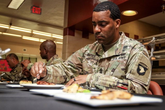 Sgt. Maj. Burke Bates, 101st Airborne Division (Air Assault) G-4 Sgt. Maj., samples and judges dishes during the 101st Abn. Div. Week of the Eagles Culinary Competition, May 21, 2019 at Fort Campbell, Kentucky. Week of the Eagles is an annual 101st Abn. Div. and Fort Campbell series of events to celebrate the rich history and legacy of the Screaming Eagles, honor our Veterans and fallen Soldiers, and strengthen bonds with our Veterans, Families, and community members.
