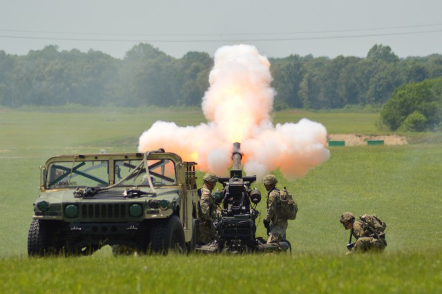 Soldiers assigned to the 101st Airborne Division (Air Assault) Division Artillery fire an M105 howitzer, May 18, 2019 at Fort Campbell, Kentucky, as part of a Week of the Eagles combat air assault demonstration before thousands of spectators. Week of the Eagles is an annual 101st Abn. Div. and Fort Campbell series of events to celebrate the rich history and legacy of the Screaming Eagles, honor our Veterans and fallen Soldiers, and strengthen bonds with our Veterans, Families, and community members.