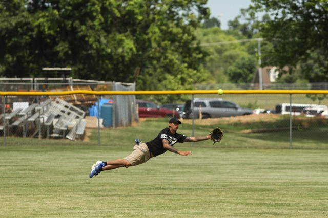 A Screaming Eagle Soldier dives for the ball during the Annual Tobacco Stick Softball Game June 1, 2019, in Clarksville, Tennessee. This is the 10th year the game has been played between the 101st Airborne Division (Air Assault) and Clarksville-Montgomery County government employees.