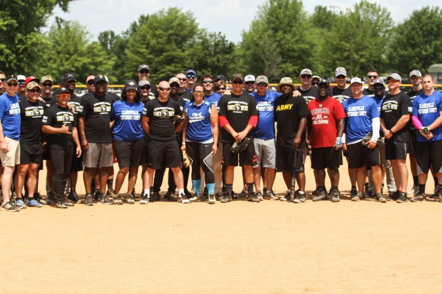 The Screaming Eagle and City-County teams pose for a group photo following the Annual Tobacco Stick Softball Game June 1, 2019, Clarksville, Tennessee. The City-County team ended a 3-year-drought defeating the Soldiers 17-8. This is the 10th year the game has been played between the 101st Airborne Division (Air Assault) and Clarksville-Montgomery County government employees.