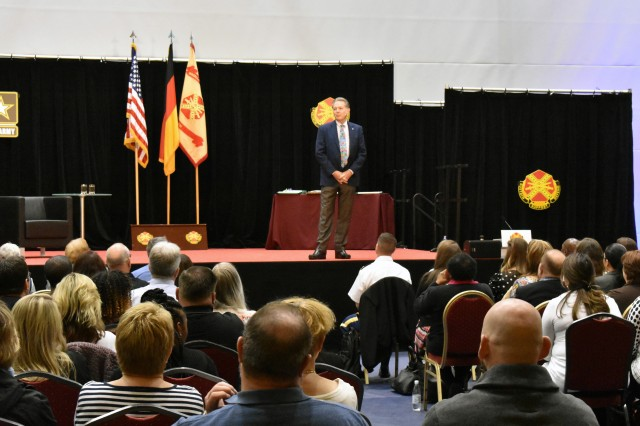 Lee Cockerell, former Executive Vice President of Operations for Walt Disney World Resort, speaks to Ansbach's civilian workforce, Soldiers and Ansbach Middle/High School students on leadership, management and customer service at Katterbach Fitness Center May 28, 2019, in Ansbach, Germany.