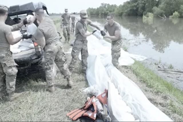 A team of Soldiers of the 2nd Battalion, 123 Field Artillery Regiment, work on levees near Winchester, Illinois, on June 1, 2019. Hundreds of Illinois Guard Soldiers are on state active duty assisting with flood control.