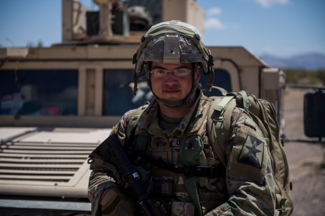 Kansas Army National Guard Sgt. Christopher Rectenwald poses for a photo June 1, 2019, at Fort Irwin, Califorina. Rectenwald, a 68W combat medic, is attached to the 242nd Engineer Company .Units from 13 Army National Guard states and territories are supporting the 116th Cavalry Brigade Combat Team's National Training Center rotation May 24 through June 20. The rotation builds unit and Soldier proficiency to provide combatant commanders with a trained and ready force capable of fighting and winning our nation's wars.