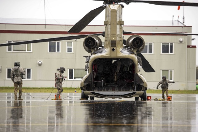 U.S. Army crew chiefs from 1st Battalion, 207th Aviation Regiment, Alaska Army National Guard and 1st Battalion, 189th General Support Aviation Battalion, Montana Army National Guard prepare for takeoff with a CH-47 Chinook helicopter at Bryant Army Airfield on Joint Base Elmendorf-Richardson, Alaska, May 7, 2019. Soldiers with the Alaska National Guard from 1-207th conduct cross-country training flights during their final annual training as an air assault unit ahead of their pending transition to becoming a part of a larger general aviation support battalion, expected to finalize this year.
