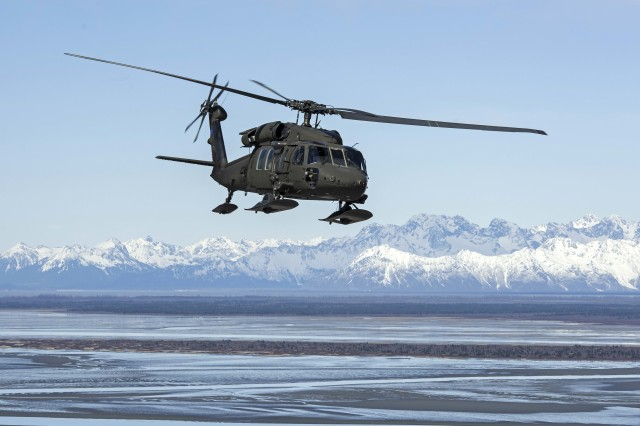 U.S. Army Chief Warrant Officer 4 Franklin Bithos, battalion standardization pilot, and Capt. Anthony Rivas, commander, Bravo Company, 1st Battalion, 207th Aviation Regiment, Alaska Army National Guard, fly a UH-60 Black Hawk helicopter from Anchorage to Juneau, Alaska, April 26, 2019. Soldiers with the Alaska National Guard from 1-207th conduct cross-country training flights during their final annual training as an air assault unit ahead of their pending transition to becoming a part of a larger general aviation support battalion, expected to finalize this year.