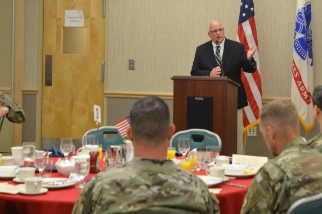 National Prayer Breakfast guest speaker, retired Chaplain (Col.) Jim Carter, shares a message May 28, encouraging attendees at the American Lake Conference Center to honor God and others with: their words, their walk, their work and through their worship.