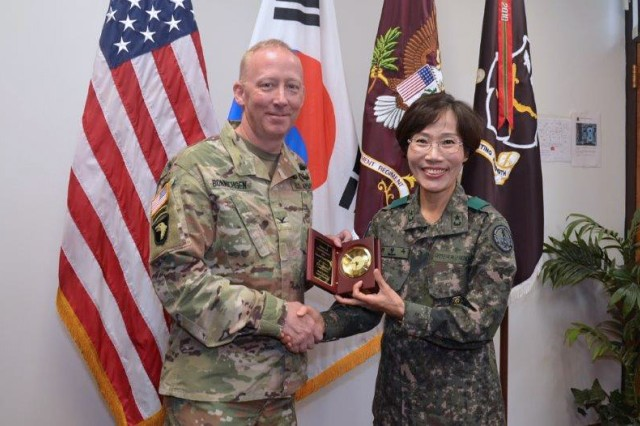 COL Daniel Bonnichsen, AMEDDC&S, Health Readiness Center of Excellence Chief of Staff and Republic of Korea Army Brigadier General Myoung-ok Kwon Superintendent for the Korea Armed Forces Nursing Academy conduct a gift exchange during a visit to the HRCoE, JBSA May 30.