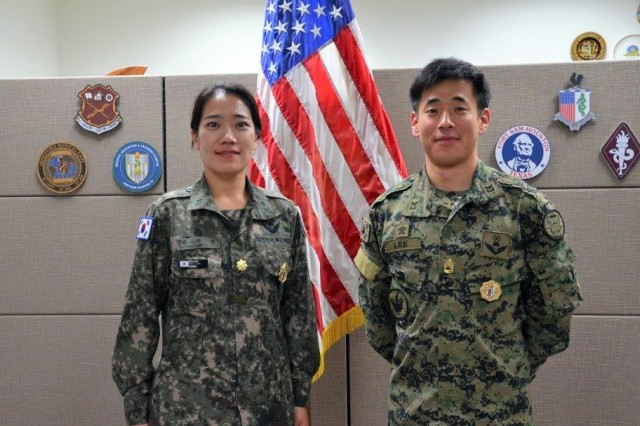 ROK Army Maj. Jisun Lee (Left) an IMS student who recently graduated from HRCoE's Principles of Military Preventative Medicine course at JBSA pictured with her countryman and IMS, ROK Army Sgt. First Class Myungjun Lee, a graduate of the Combat Medic Specialist Course.