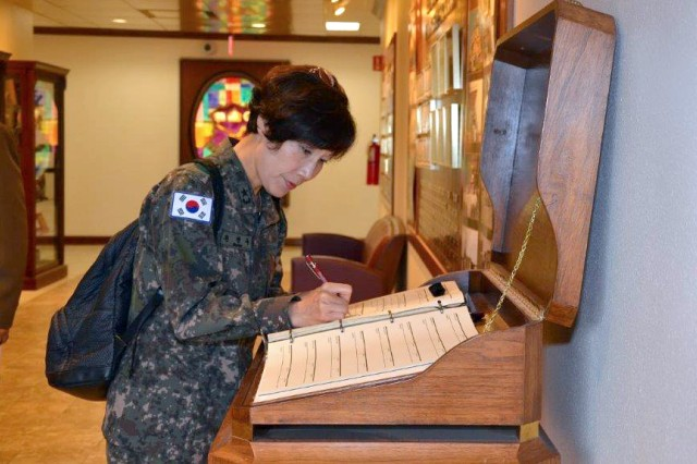 ROK Army Brig. Gen. Myoung-ok Kwon, Superintendent for the Korea Armed Forces Nursing Academy signs the distinguished visitor log book at the HRCoE International Military Student Office 22 years after she graduated from what is now the Captains Career Course at the HRCoE on JBSA.