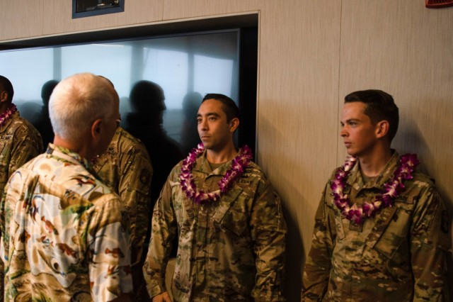 Hawaiian Airlines employees greet Soldiers from the 94th Army Air and Missile Defense Command during a luncheon held on May 24, 2019, in Honolulu, Hawaii. They were recognized for their brave efforts in subduing a belligerent passenger on their flight to Korea back on Feb. 27, 2019.