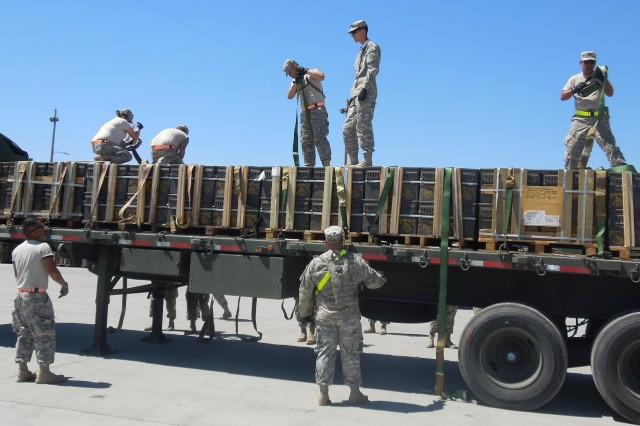 U.S. Army Reserve soldiers secure ammunition for shipment during Operation Golden Cargo at Hawthorne Army Depot.