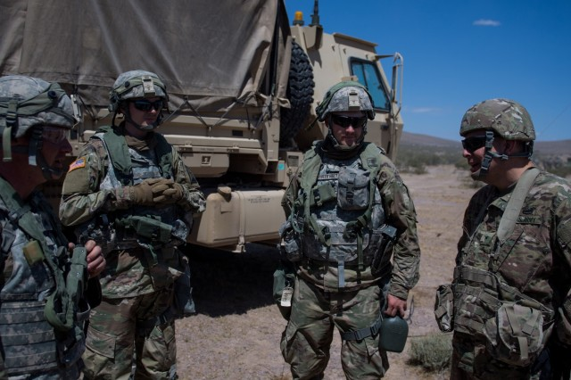 Soldiers from the 891st Engineer Battalion's 772nd Engineer Mobility Augmentation Company prepare to move into position June 1, 2019, at the National Training Center in in Fort Irwin, California. The 772nd MAC is one of two Kansas Army National Guard companies supporting the 116th Cavalry Brigade Combat Team's National Training Center rotation. Units from 13 Army National Guard states and territories are supporting the 116th CBCT's rotation May 24 through June 20. The rotation builds unit and Soldier proficiency to provide combatant commanders with a trained and ready force capable of fighting and winning our nation's wars.